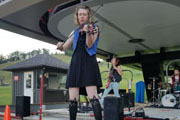 Using the base of a ski lift as a stage, Traverse City-based folk/rock trio The Accidentals give a high energy concert performance following Tuesday evening's outdoor dinner.
