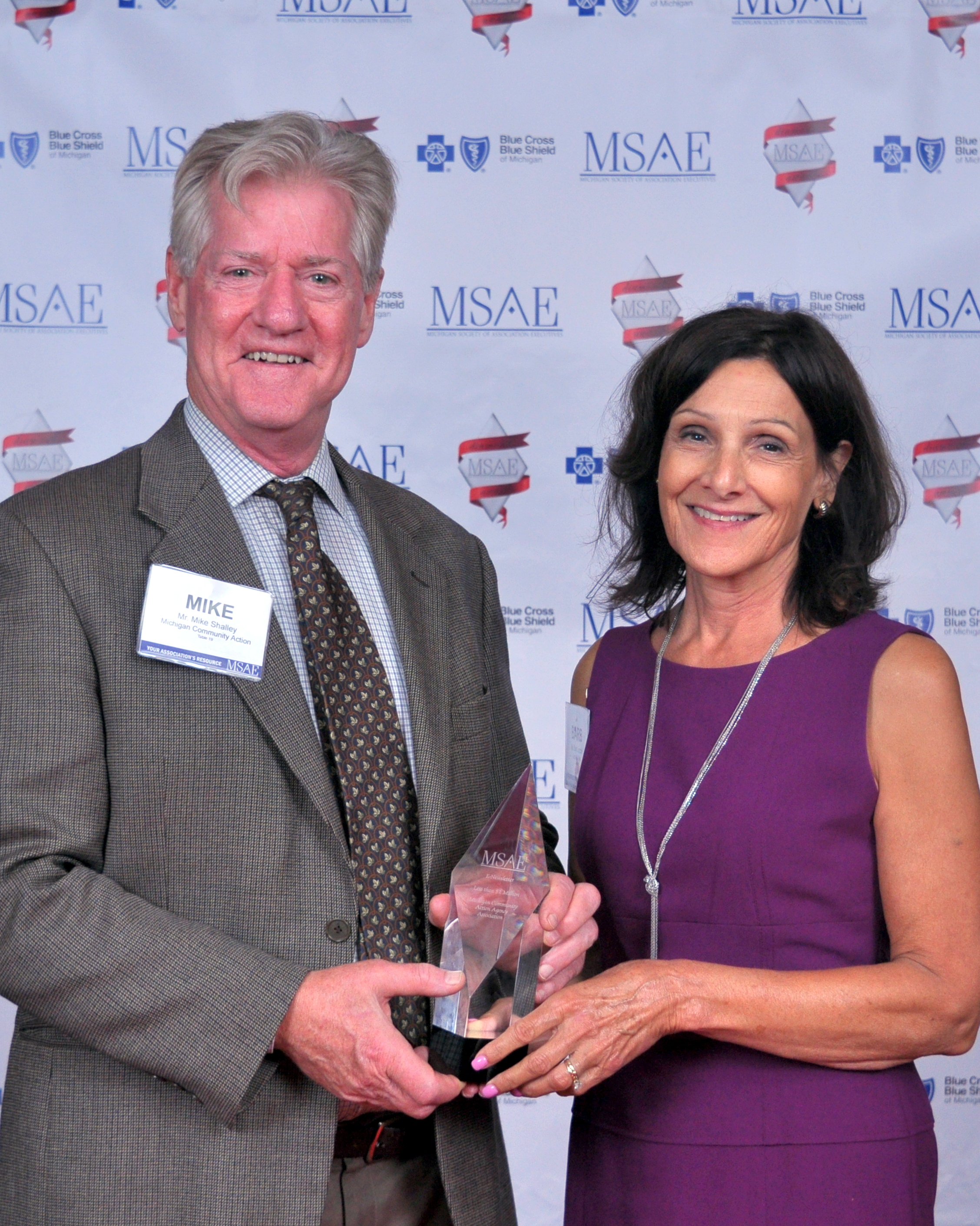 Mike Shalley, Member Services Director and Barb Lezotte, PR Consultant, accept the Diamond Award
